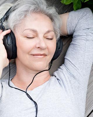 mature-happy-women-listening-music